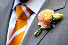Gentlemen will wear grey suits accented with a peach boutonniere