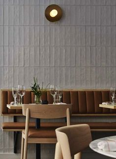 Tan leather seating and tiled walls | Michel Helsinki (Restaurant Upholstery)