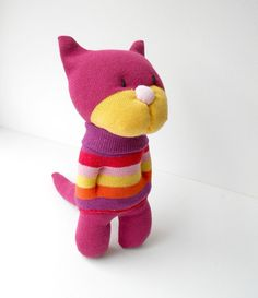 Cat, kitten, sock animal, sock creature, plush animals, soft sculpture made from socks.    Felicity is a pretty little cat who has been lovingly hand sewn from new socks. She wears a stripy sock jumper, has sculpted features and embroidered eyes. She is stuffed with new hollow fibre toy filling and measures approximately 8 inches high.    Felicity has been made to my own original design. She would make an adorable little companion.