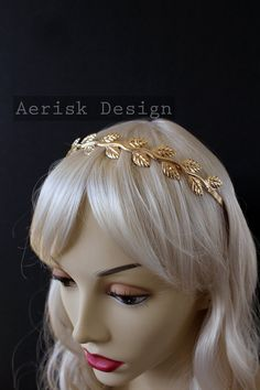 Bring out the goddess in you with this Greek Laurel wreath. One with Mother Nature and summon your muse! You are the master of your own destiny with this ancient symbol of victory and status. Made with Silver plated metal. A light weight metal headband is fitting any special occasion or for a statement ensemble. Crown: Free size fit (one size fits most)  Tuck the combs into your hair for stability and seamless fit.