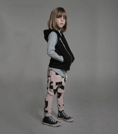 Add a funky touch to your nununu kid's wardrobe with our powder pink punctuation…