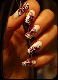 Large flowers and fuschia swirl nail art