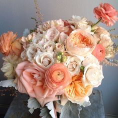 Bouquet of roses, spray roses, stock, ranunculus and dusty miller foliage