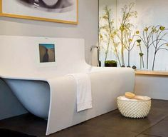 """The Strip Bathtub from Belgium bathroom products manufacturer Aquamass delivers an unbelievably clean and unique look, that is achieved by its overflowing """"skirted"""" effect on the Wall Strip (pictured above) and the free-standing Strip Slice (shown after the jump)"""