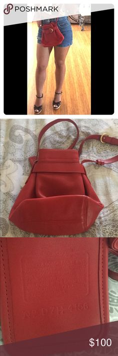 Coach shoulder bucket bag Red. Authentic Vintage! Almost like new except for a small and barely noticeable mark on lower front part of bag. Soft grain leather. Gold buckle cinches in the top. This bag is like the new coach soho collection. Durable and a classic! Coach Bags Crossbody Bags