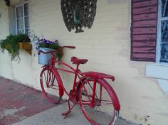 Bicycle as a sidewalk decoration and flower basket, Gore, Oklahoma