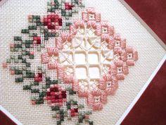 Emie Bishop hardanger design made with Kreinik silk threads. Free project to download.