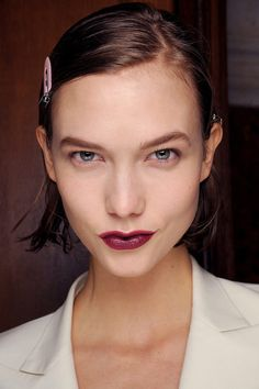 Karlie Kloss shows off a strong berry mouth at Lanvin, FW13.