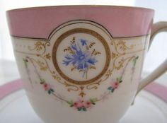 This cup carries the favorite symbols of Marie Antoinette, the pink rose and the blue cornflower.