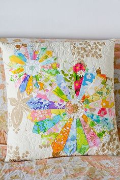 Love the pillows + provides a little inspiration for a shelf of vintage quilt blocks and pieces awaiting repurposing.