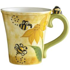 "Create a buzz at the office. Take the sting out of mornings. ""How about more coffee, honey?"" We got a million of 'em. Jokes, that is. For cute hand-painted mugs, the supply could be less than that. Come in soon.  <br> </br> <li>Green/Yellow</li> <li>5.25""W x 3.75""D x 4.50""H</li><li>14oz</li> <li>Dolomite</li> <li>Hand-painted finish</li>"