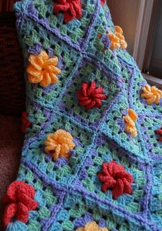 What a pretty 3 dimensional square used in this afghan!  My great grandma made a blanket with a very similar pattern to this square using pastels as my baby blanket!  I still cherish it, and it covers my night table