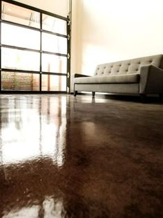 Apply an acid-stain look to concrete flooring using environmentally-friendly dye.