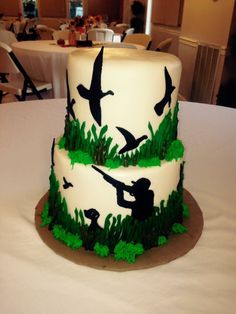 Hunting grooms cake! Hunter with his dog. All figurines are hand-cut out!