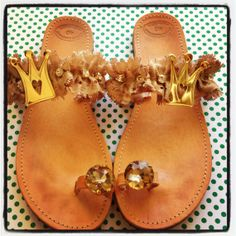 Handmade leather sandals decorated with beige lace, crowns and crystal beads.