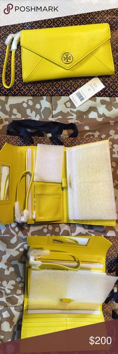 NWT- Tory Burch clutch/wristlet- sunshine color Stylish shiney Yellow Tory Burch clutch with wristlet handle for a night out or Sunday brunch. Size- approximately 8 in. long and 5 in. Height. Fits a phone, check book, and has many pockets and slots for items along with mirror. Magnetic closure. Tory Burch Bags Clutches & Wristlets