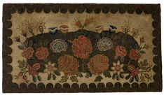 HOOKED RUG DEPICTING A VIBRANT FLOWER GARDEN OF ROSES AND LILIES WITHIN A DOUBLE SCALLOPED BORDER. Worked in pinks, blues and greens on a tan ground. Mounted to a board, 39 x 70 inches.