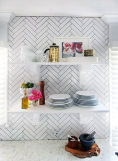Floating shelves gave Kristin the open feeling she craved while allowing her to still show off the tiled ac...