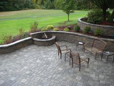 Neat fire pit + Patio design with garden