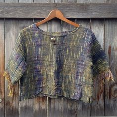 NWOT Woven multicolored crop top Beautiful multicolored woven top, with a pewter elephant accent and small beads along the collar. sleeves are fringed. Never worn. would fit xs/s/m, just sit differently. Tops Crop Tops