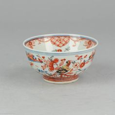 0298. Amsterdams Bont Bowl (clobbered). Blue and white china, decorated in Europe. The underglaze blue decoration (which was made in China) is a landscape painting with a fisherman. Overpainted in red, gold green and black. Decoration with the populair flowers in a basket decoration on the inside and a very cool parrot on the outside. Marked with an unclear swatsika symbol. Symbol is known for prosperity and fortune. 18th century Diameter: 185mm approx View all collection items on FB