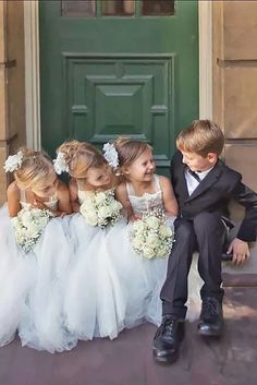 sweet shot of the flower girls and ring bearers