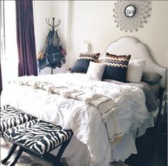 We would hit the snooze button a few more times if this was our bedroom! @styleMBA scored the sunburst mirror and zebra benches from HomeGoods! #decor #HomeGoodsHappy