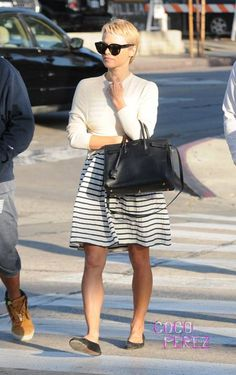 Cute striped full-skirted dress and flats ... on Pamela Anderson, with her new pixie cut. WOW.