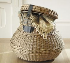 The PB catalog had two of these baskets sitting on the floor under a desk- loved the look.
