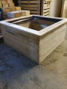 1m square x 500mm high raised bed constructed wholly from reclaimed pallets wood lats and runners
