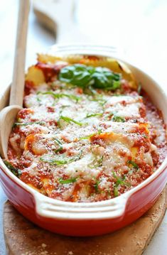 Baked Ravioli - Amazingly cheesy, creamy, comforting ravioli made in 30 minutes or less, perfect for those busy weeknights! Idamndelicious.net.