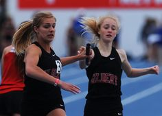Gilbert's Carley Rahn and Cara Heuer exchange baton during 3A girls 4x800 meter relay in the Iowa State High School Co-ed Track & Field championship at Drake Stadium Thursday, May 18, 2017, in Des Moines, Iowa. Photo by Nirmalendu Majumdar/Ames Tribune http://www.amestrib.com/sports/20170518/prep-track-and-field-gilbert-girls-win-4x800