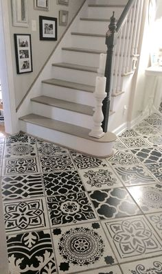 I stenciled my hallway ceramic tiles to add a sophisticated  style trend to my plain tile floor.  I used several stencil patterns to create the look of encaustic cement tiles.  The picture does not due this artistic DIY project justice. Use porch and patio paint and seal your work with three coats of varathane floor satin poly.: