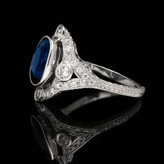 Blue Sapphire Diamond Platinum Ring | From a unique collection of vintage cocktail rings at https://www.1stdibs.com/jewelry/rings/cocktail-rings/