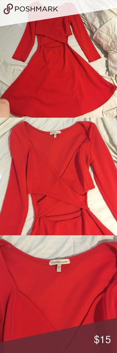 Red dress by  Charlotte Russe Cute red dress with 3/4 sleeves and open criss cross front of dress! Only worn once! Dress is like new! Charlotte Russe Dresses Mini