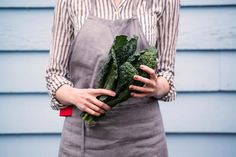 Woman Holding a Bunch of Kale