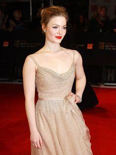 Holiday Grainger in Valentino.  BAFTA 2012.  That red lippie is killer....