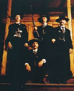 Three would west sexy bunch :)  Val Kilmer as Doc Holliday, Bill Paxton as Morgan Earp, Sam Elliott as Virgil Earp, and Kurt Russell as Wyatt Earp.