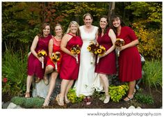 Gorgeous red mix & matched bridesmaids dresses in different styles to match each bridesmaid's body type.