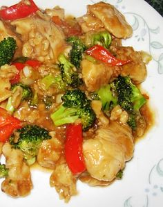 General tso's chicken stir fry: Sugar, rice vinegar, hoisin sauce, sesame oil, soy sauce, cornstarch, ginger, garlic, green onions, chicken breast, egg, soy sauce, flour, red pepper, broccoli florets