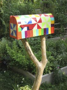 Gardening mailbox painted with a quilt design for my garden
