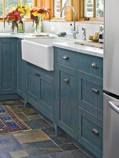 Rustic flagstone flooring in blue & green hues + rich blue cabinetry