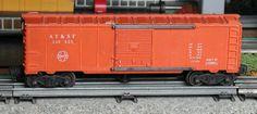 Lionel postwar # 3484-25 Santa Fe operating boxcar.