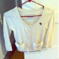 A&F sweater One off white sweater. Children's XL fits like adult SMALL. Off white  3/4 sleeve sweater with navy moose and navy stitching along the bottom with bow detailing on pockets. Abercrombie & Fitch Other