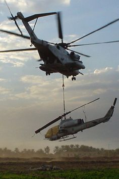 CH53 hauling an AH1Q.  Air Cargo Inception!  www.philjets.com/aerial-work  #AerialWork #AirCargo #HeavyLifting