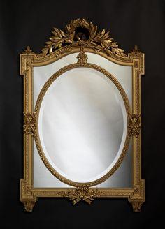 Espejo Luis XVI  de madera tallada y dorada  espejo con placas biseladas francés, hacia 1890.