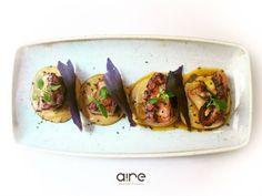 Tacos de pulpo asado con humus, sésamo negro y pimentón. Reserva online en…