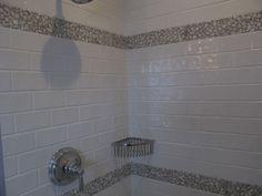 3x6 Basics Snow White Shower w/ Carrara Pebble accent.  www.architecturalceramics.com