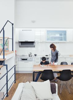 """The black facade of Motoshi Yatabe's house in Saitama, a tightly packed neighborhood near Tokyo, belies its bright interiors. Called the """"LDK,"""" for living, dining, and kitchen, the main interior space is flexible—a blend of Western loft life and traditional Japanese homes, where rooms are multipurpose. Photo by Dean Kaufman."""