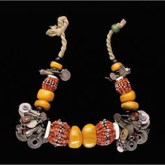 Africa | Berber Necklace worn by the Muslim Ida ou Semlala women from the western Anti-Atlas region of Morocco.  ca. early 20th century | Amber, coral, shell, silver alloy, glass, enamel, cotton
